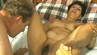 Charming milf has her pussy licked before getting fed with a huge throbber