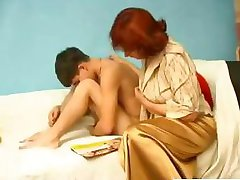 Mature chubby Russian redhead gives this young boy some hot lips