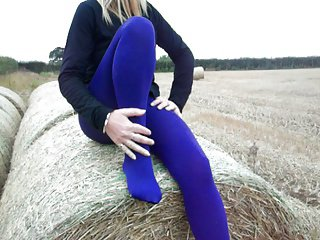 mature legs in coloured tights outdoor