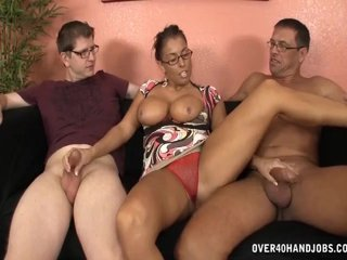 Busty lady jerking two cocks
